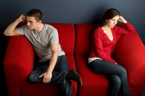 couple-fighting-on-couch