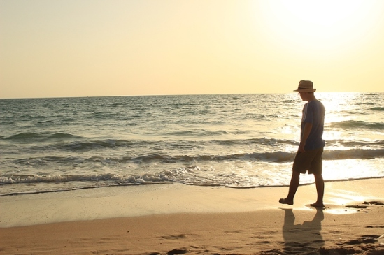 man-walking-alone-on-beach-5184x3456_99525